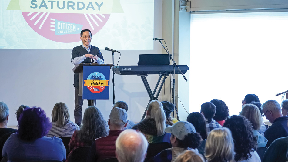 Commission Cochair Eric Liu delivers a sermon during Civic Saturday at Impact Hall in Seattle on October 5, 2019.
