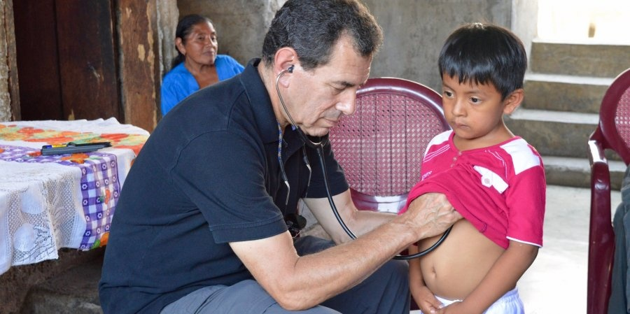 Paul Wise treating a child in a rural village in Guatemala