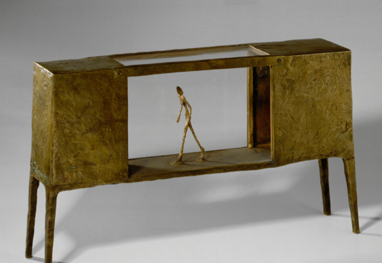 Sculpture of man walking through empty space