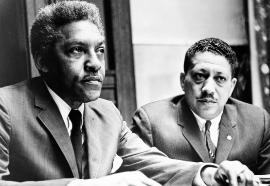 Civil rights activists Bayard Rustin and Eugene Reed speak at Freedom House