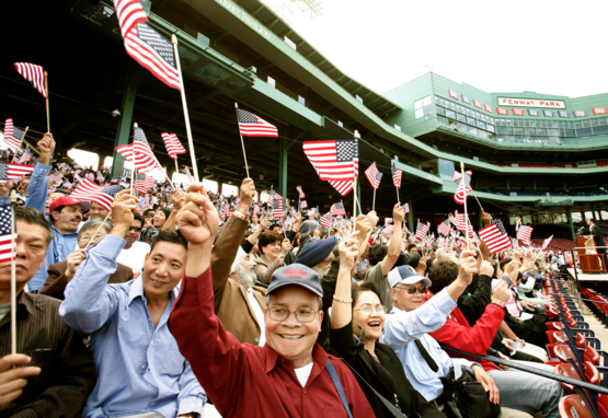 Immigrants cheer during naturalization ceremony at Fenway Park