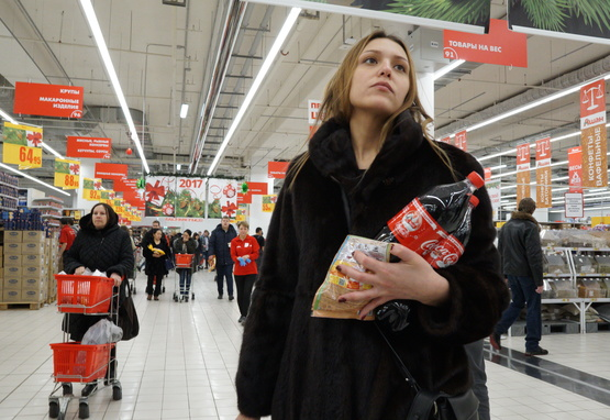 Woman shopping in Russian supermarket
