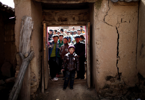 Villagers gather together in rural China