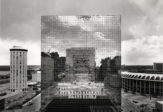 Old courthouse reflected in glass of new courthouse in St. Louis