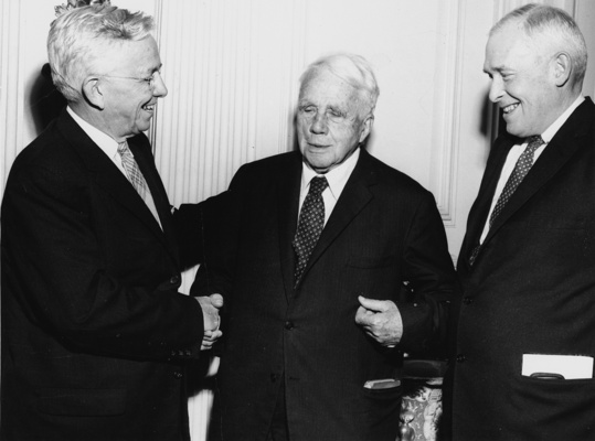 Kirtley F. Mather, President of the Academy (left) and Kenneth B. Murdock, Chair of the Emerson-Thoreau Award Committee (right), present poet Robert Frost with the Academy's first Emerson-Thoreau Award in October 1958